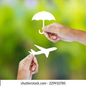 Hand holding paper on green background, Travel Insurance