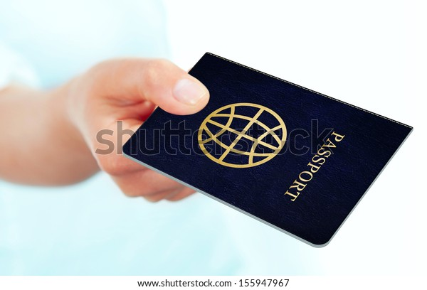 hand holding passport isolated over white background