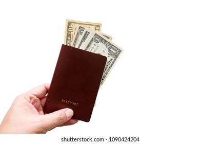 Hand holding passport and us dollar banknote isolated on white background with clipping path.