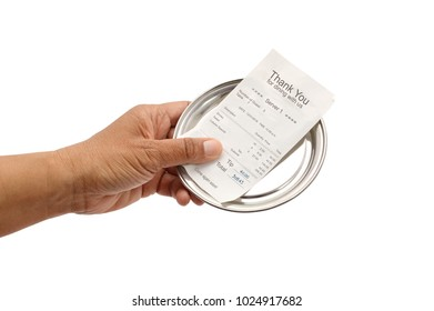 Hand holding paying completed restaurant bill with tip and total white background