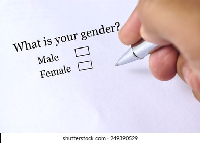 """Hand Holding Pen to Tick """"GENDER"""" On Questionnaire , Selective Focus"""