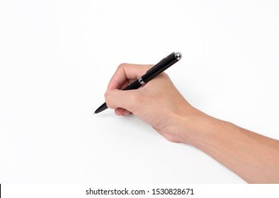 Hand holding pen writing on white background, closeup.