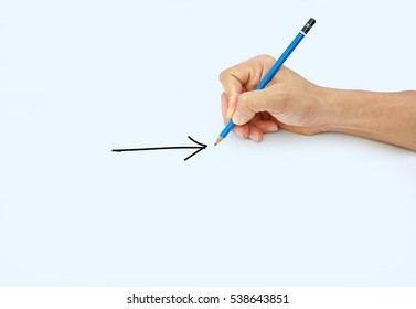 Hand holding a pencil on a white paper background, Drawing with pencil for Sign of Arrow