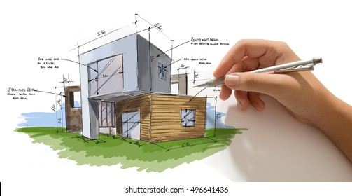Hand holding a pencil working on a house project draft