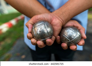 Hand of holding petanque ball.