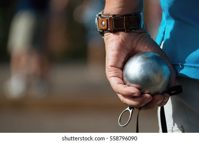 Hand of holding petanque ball,fun and relaxing game