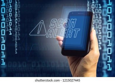 Hand holding phone with digital sign SCAM ALERT