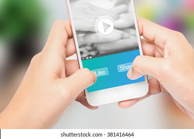 Hand holding the phone label like and share message, Can be used in advertising