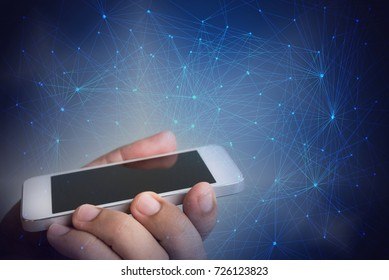 hand holding the phone over abstract connection line background