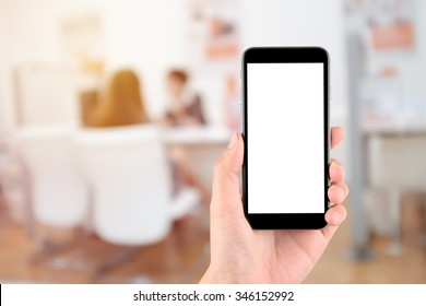 hand holding the phone tablet on blurred in shop counter service background;Transactions by smartphone concept