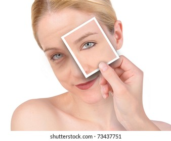 A hand is holding up a photo of a young, eye on a wrinkled woman's face. She is isolated on a white background.