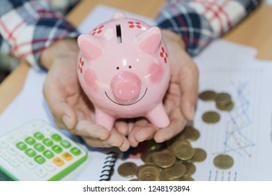 Hand  holding  pink piggy bank, Save money and financial investment, Financial hedging, Risk management, financial or saving concept
