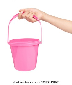 hand holding Pink plastic bucket for water isolated on white background
