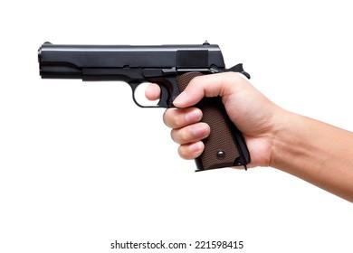 Hand holding pistol gun, finger on the trigger 11 mm