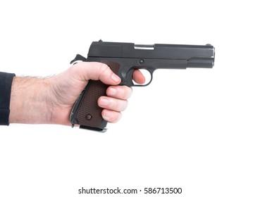 Hand holding pistol handgun isolated on white background