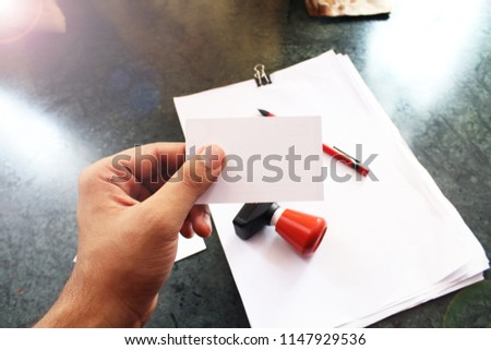 hand holding plain white business card stock photo edit now