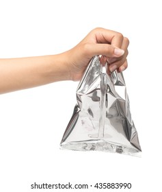 hand holding plastic bag snack packaging isolated on white background