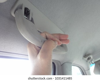 Hand Holding Plastic Car Grab Handler for The Passenger in A Car.