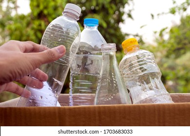 hand holding plastic recycle for cleaning