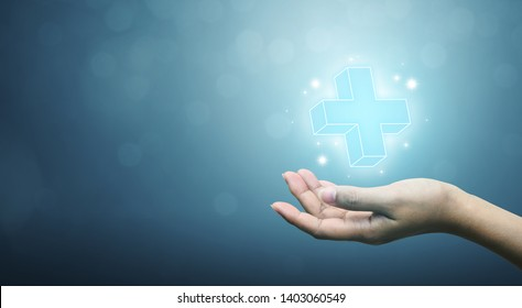 Hand holding plus sign virtual means to offer positive thing (like benefits, personal development, social network, health insurance) with copy space