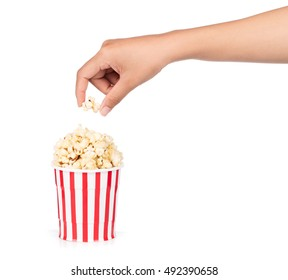 hand holding Popcorn in striped bucket isolated on white background