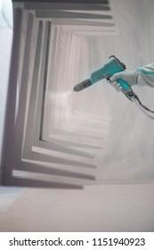 Hand holding powder coating sprayer