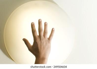 Hand holding power ball bulb