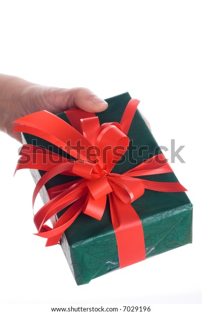 Hand holding a present against white background