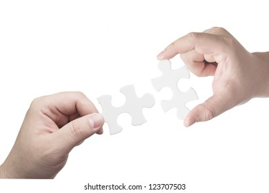 Hand holding puzzle piece trying to complete the puzzle. Concept for complete for business success