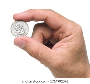 A hand holding a quarter dollar coin with two fingers, isolated over a white background.