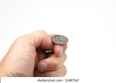 A hand holding a quarter, just about to flip a coin.
