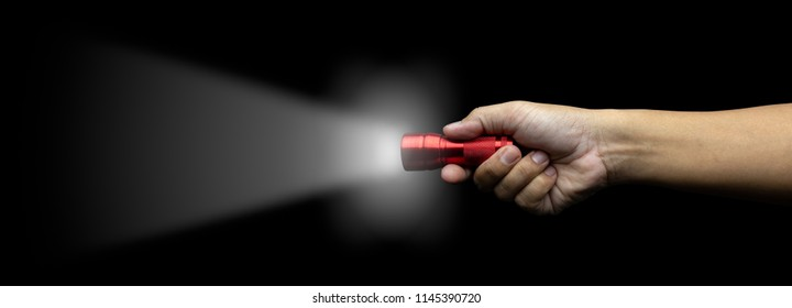 hand holding red flash light with growing lighting isolated on black background with clipping path