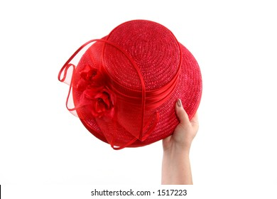 hand holding red hat