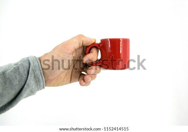 hand holding a red mug isolated
