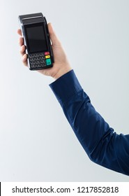 Hand is holding a redit card payment terminal on blank background.