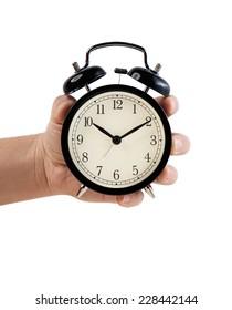 Hand holding Retro style alarm clock, isolated on white background