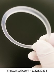 Hand holding a ring contraceptive