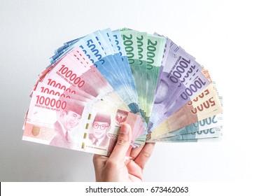 hand holding rupiah Indonesian money