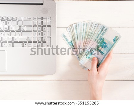 Hand Holding Russian Rubles Near Laptop Stock Photo Edit Now