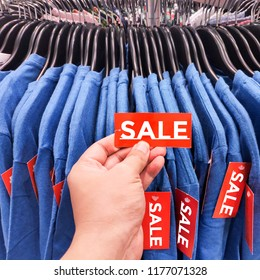Hand holding Sale Red Label Tag.Best price shopping offer.Discount sale promotion sign banner.Special to purchase symbol.End of Sale season shopping.