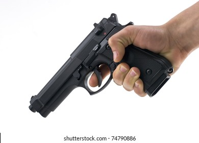 hand holding a semi automatic handgun