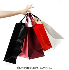 Hand holding shopping bags,isolated on white