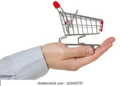 Hand holding shopping cart. Isolated  on white background