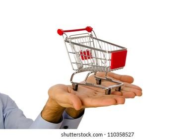 Hand holding shopping cart on white