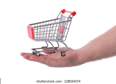 Hand holding shopping cart trolley isolated on white, concept of shopping at your finger tips