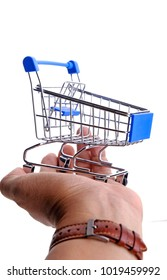 Hand holding shopping trolley on white background