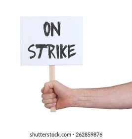 Hand holding sign, isolated on white - On strike