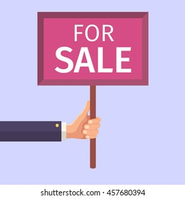 Hand holding sign. For sale