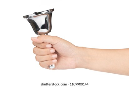 hand holding silver hand bell isolated on a white background.