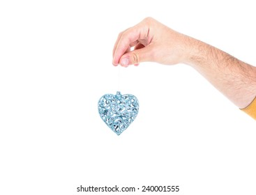 Hand holding a silver christmas decoration